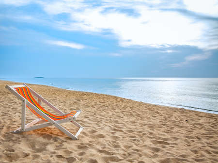 unspoilt: beach chair on tropical white sand Stock Photo
