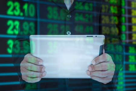 exchange rate: Businessman and smart phone in hand with exchange rate blur background Stock Photo