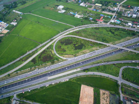 aerial view of traffic junction and transportation road in city, top and birdeyes view shot 90 degree, blur background