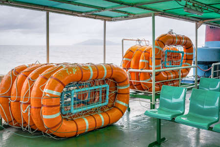 safety buoy: life buoy stack on ship or boat for security and safety concept background Stock Photo
