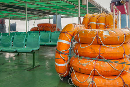life buoy stack on ship or boat for security and safety concept background Stock Photo