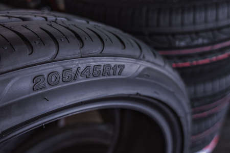 car tire size for sale represents the dimensions and construction type of tyre show on background Archivio Fotografico