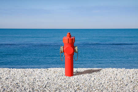 illogical: Hydrant on the seashore  concept image