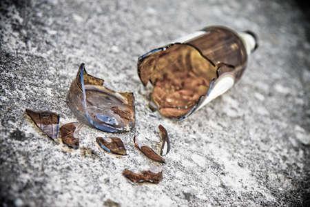 Shattered brown beer bottleSelective focus