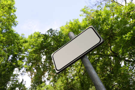 an insertion: Blank sign in countryside - space for text insertion