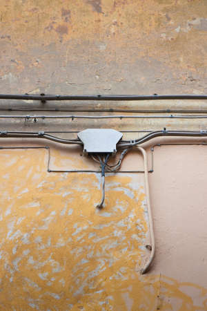 electricity supply: An old electrical junction box fixed on the wall, for the distribution of electricity supply