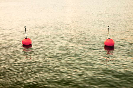 swaying: Bouy by the lake - Red bouy on a calm lake Stock Photo