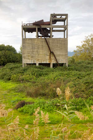 man made structure: Old abandoned concrete structure overtaken by nature