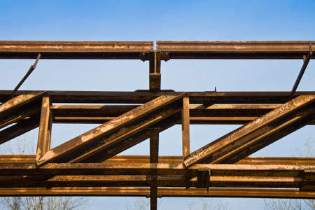 Old iron structure on blue background