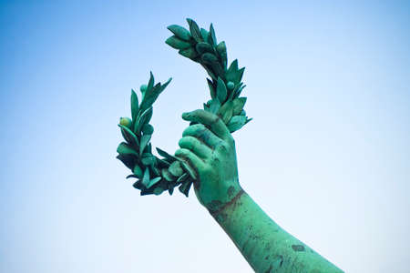 Laurel Wreath hand held by a bronze statue