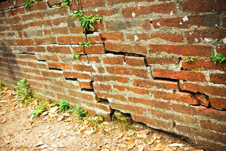 infiltration: Cracked brick wall - Deep crack in a brick wall Stock Photo