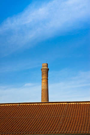 copy sapce: Old brick chimney isolated on sky with copy sapce
