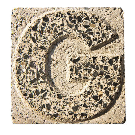 concrete block: Letter G carved into a concrete block - A concrete block with the letter \ G \ carved into it. Stock Photo
