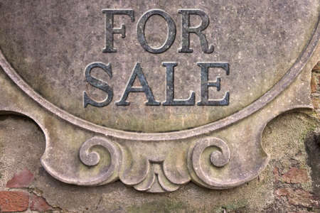 short phrase: For Sale concept - For Sale written on a stucco wall