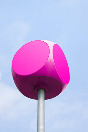 rounded edges: Magenta cube with rounded edges against sky background with copy space