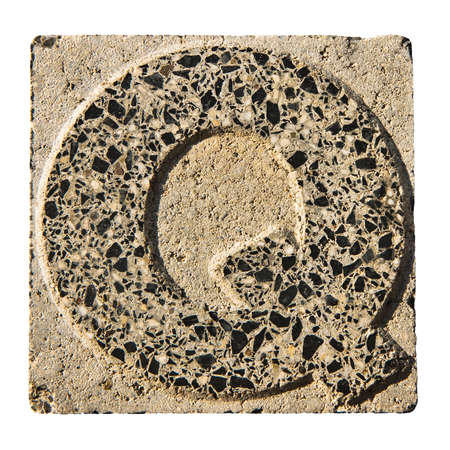 """quot: Letter Q carved in a concrete block - A concrete block with the letter  """"Q """" carved into it."""