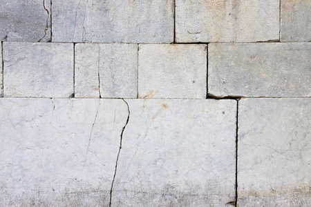lesion: Cracked stone wall - lesion on a stone wall Caused by subsidence of the foundation