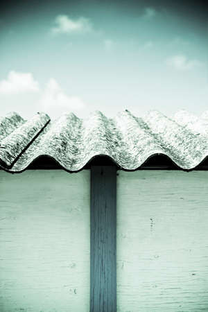Dangerous asbestos roof - Medical studies have shown that the asbestos particles can cause cancer Stock Photo