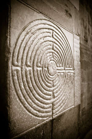 11th century: Labyrinth carved on the facade of a Romanesque church of the 11th century (Tuscany - Italy)