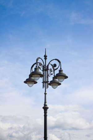 19th: Streetlight of the 19th century in the middle of an Italian square Stock Photo