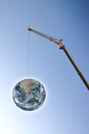 suspended: The globe suspended to a thread. Environmental emergency concept