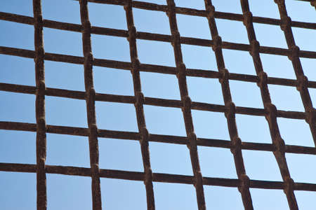 metal grate: Metal grate against a blue sky - freedom concept