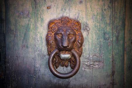door knocker: Door knocker - Old rusty door detail Stock Photo
