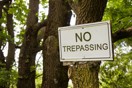trepassing: No Trepassing Sign indicating in the countryside - concept image Stock Photo