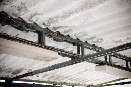 carcinogen: Dangerous asbestos roof - Medical studies have shown that the asbestos particles can cause cancer Stock Photo