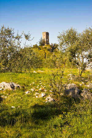 watchtower: Small abandoned watchtower perched on a rock Stock Photo