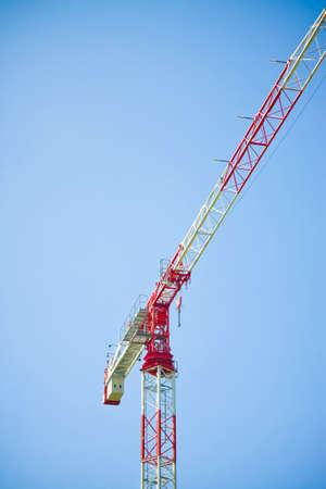 tower crane: Tower crane on blue background Stock Photo
