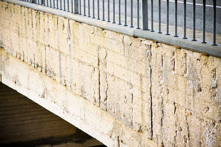 spall: Damaged concrete caused by rusting reinforcement bars Stock Photo