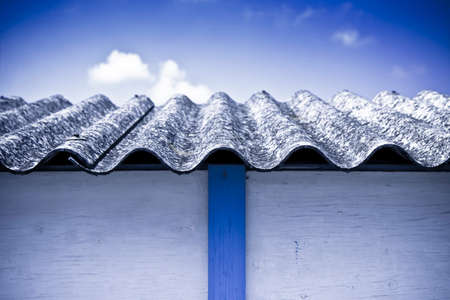 asbestos: Asbestos roof - Medical studies have shown that the asbestos particles can cause cancer Stock Photo