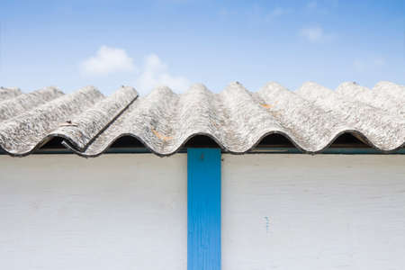 cancerous: Dangerous asbestos roof - Medical studies have shown that the asbestos particles can cause cancer Stock Photo