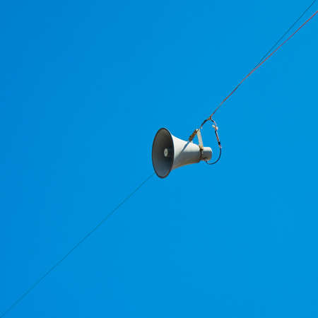 Loudspeaker isolated on blue background whit copy space