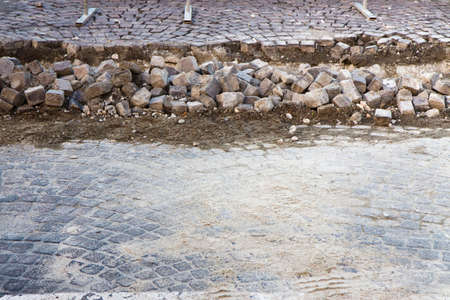 substructure: Road repairs in a stone road - image with copy space Stock Photo