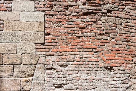 barrie: Italian stone wall - Typical Italian stone and brick wall Stock Photo