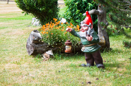 lawn gnome: Gnome holding a lantern and smoking a pipe