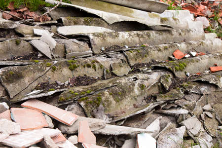 punishable: Illegal asbestos dumping Roofing asbestos panels illegally abandoned in nature