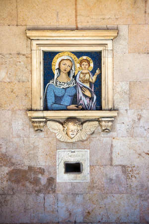 largesse: Old charity box embedded in a stone wall. On the wall you can see the inscription: La limosina pi poveri prigioni which means The alms for the poor prisoners.