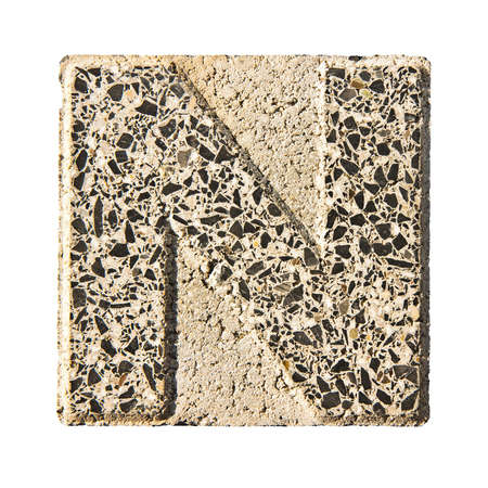 concrete block: Letter N carved in a concrete block - A concrete block with the letter N carved into it.