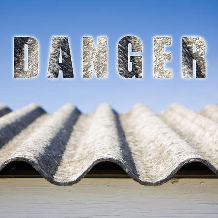asbestos: The word danger written with letters having asbestos graphics background