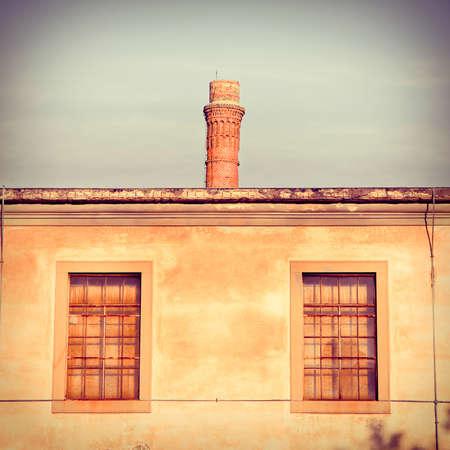 smokestack: Old factory with smokestack - toned image - (Tuscany, Italy)