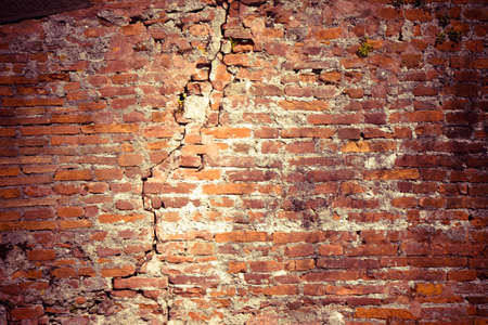 foundation cracks: Cracked brick wall - Deep crack in a brick wall -Toned image