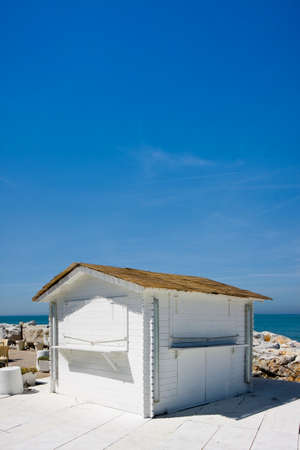 Small white cottage by the sea - image with copy space Stock Photo