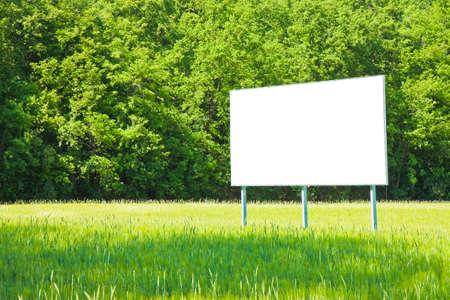 billboard blank: A blank advertising billboard immersed in a wheat field Stock Photo