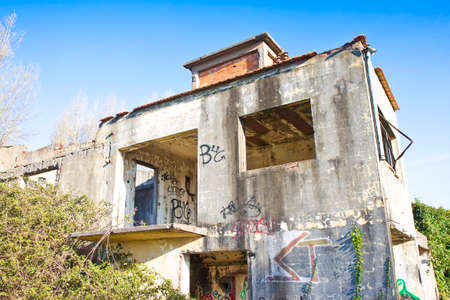 overtaken: Old abandoned concrete factory structure overtaken by nature