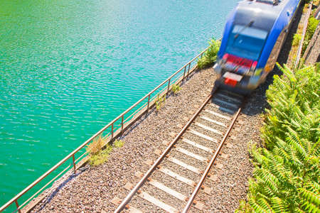 travel industry: Detail of Italian railway seen from above with incoming train (Italy - Europe)