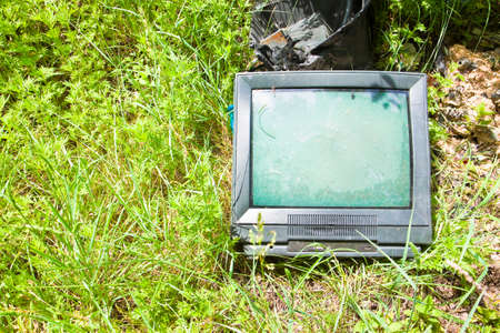 crt: Old television CRT abandoned in a illegal dump Stock Photo