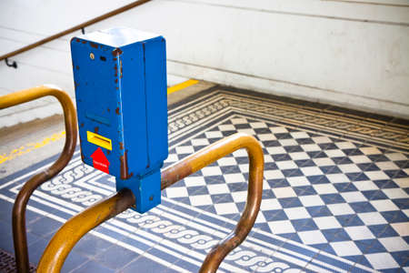 validating: Colored obliterator in a old Viennese metro railway Stock Photo